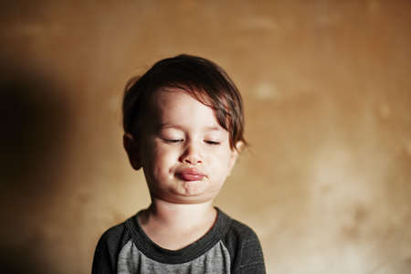 Portrait of cute male toddler pulling faces