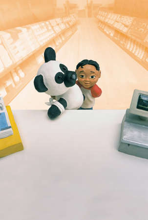 enhanced healthy: Model of boy carrying bandaged panda toy in front of pharmacy counter