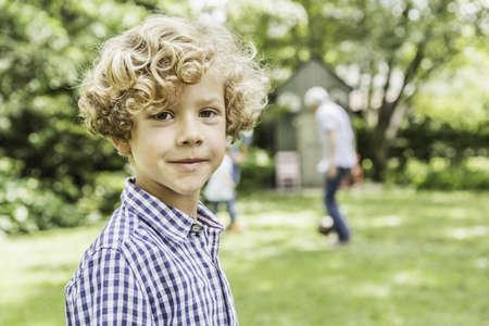 grampa: Portrait of cute boy in garden