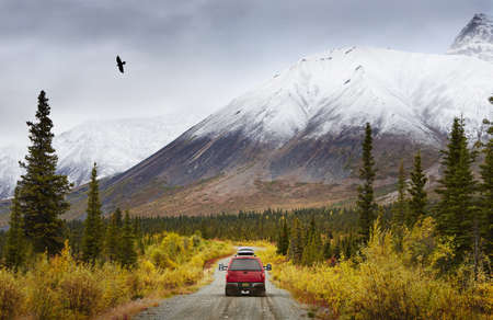 Recreational vehicle on rural road, Wrangell St. Elias, Alaska, USA
