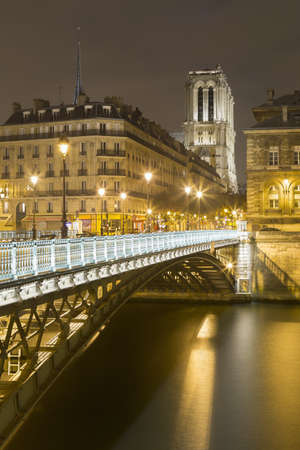 View of Pont dArcole and Notre-Dame Cathedral at night, Paris, France