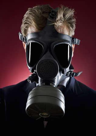 30 years old man: Studio portrait of man wearing gas mask LANG_EVOIMAGES