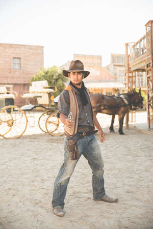 thespian: Portrait of cowboy pointing gun on wild west film set, Fort Bravo, Tabernas, Almeria, Spain