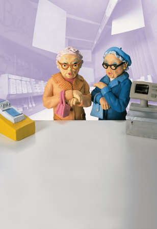 enhanced healthy: Model of two senior women standing in front of pharmacy counter LANG_EVOIMAGES