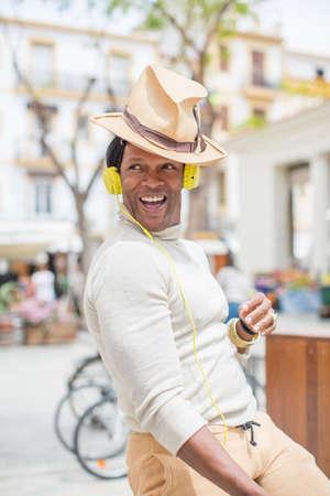 southern european descent: Portrait of man listening to headphones, Ibiza, Spain LANG_EVOIMAGES