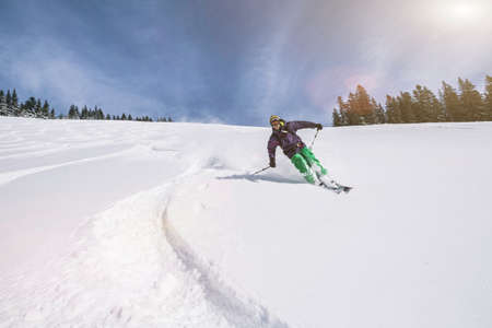 liberating: Male skier swerving down snow covered slope, Spitzingsee, Germany LANG_EVOIMAGES