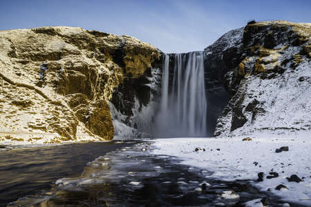 Skogafoss waterfall in winter, South Iceland LANG_EVOIMAGES