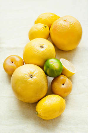 Still life of fresh grapefruits with lemons and lime
