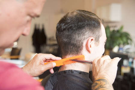 Young man having his hair cut