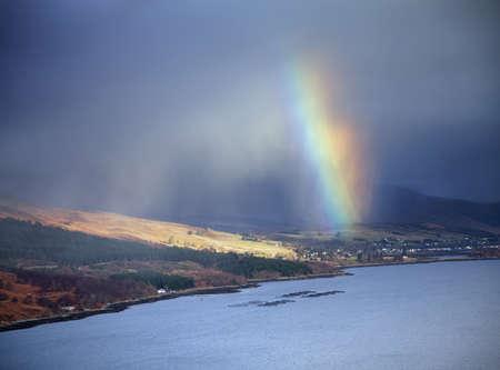 Rainbow over loch, Assynt, Scotland, UK