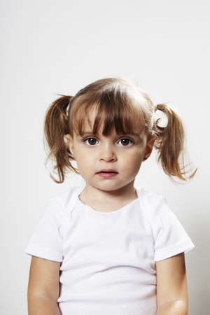 Portrait of young girl with pigtails LANG_EVOIMAGES