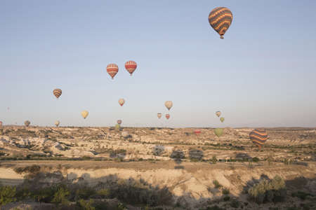 trip over: Large group of hot air balloons above landscape, Cappadocia, Anatolia,Turkey