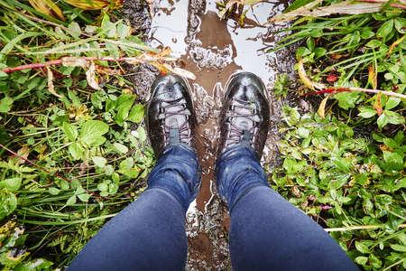 Hiking boots on muddy trail, Palmer, Alaska, USA LANG_EVOIMAGES