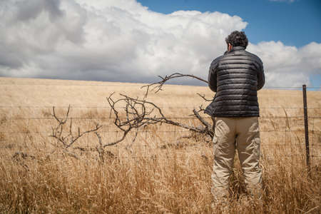 fenced in: Photographer taking photograph of rural scene, Tasmania LANG_EVOIMAGES