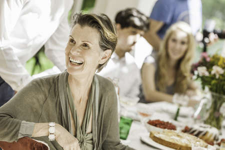 Senior woman at family birthday party in dining room