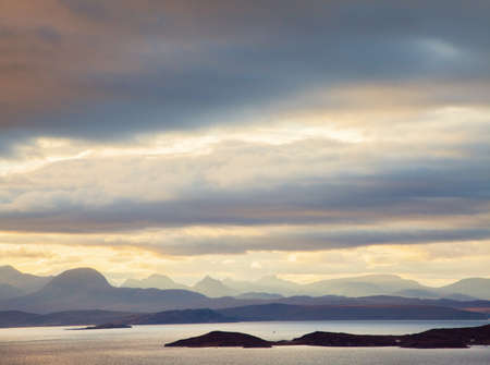 Dramatic storm clouds over mountains of North West Highlands, Scotland, UK LANG_EVOIMAGES