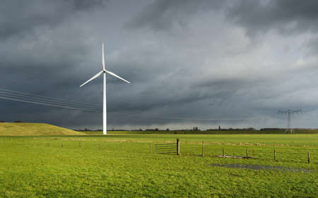 Wind turbine and solar panels on former waste dump, Waalwijk, Noord-brabant, Netherland LANG_EVOIMAGES
