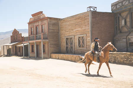 Cowboy riding horse on wild west film set, Fort Bravo, Tabernas, Almeria, Spain