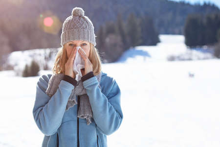 Woman suffering with cold