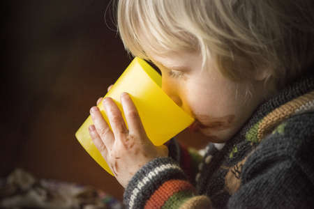 3 4 years: Portrait of young boy drinking from beaker LANG_EVOIMAGES