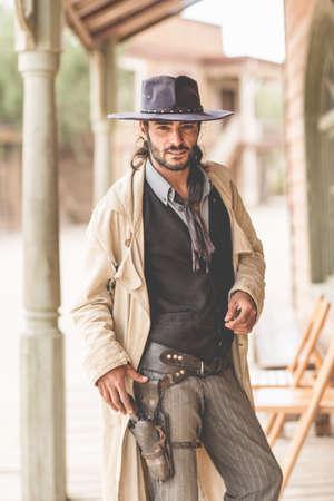 Portrait of cowboy on porch on wild west film set, Fort Bravo, Tabernas, Almeria, Spain LANG_EVOIMAGES