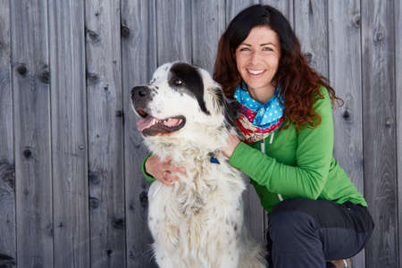 wood panelled: Woman bonding with pet dog