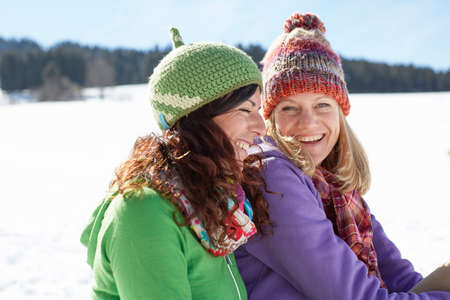 sun energy: Women enjoying day out in snow LANG_EVOIMAGES