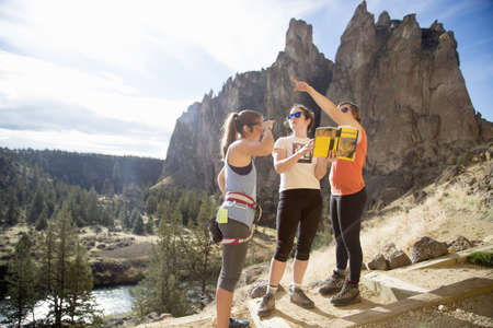 Hikers looking at view, Smith Rock State Park, Oregon, US