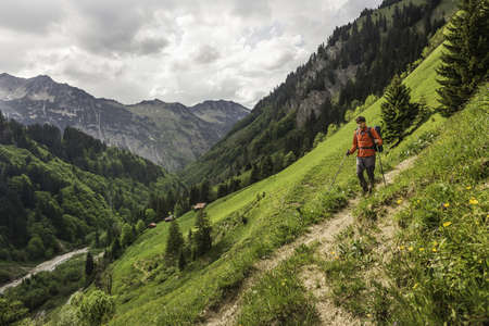 Young man hiking on valley path, Oberstdorf, Bavaria, Germany