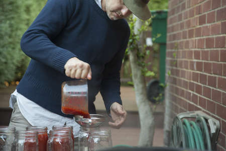 vacant land: Man potting jam