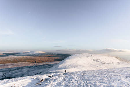 brecon beacons: Person hiking in distance, Llyn y Fan Fach, Brecon Beacons, Wales