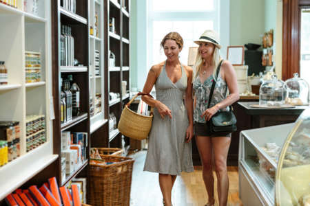 Two female friends browsing in organic grocery