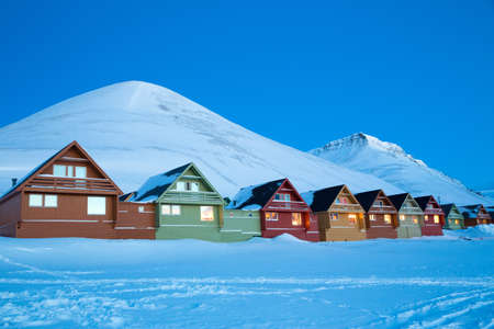 Row of traditional houses at dusk, Longyearbyen, Svalbard, Norway