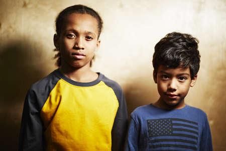 Two boys looking at camera