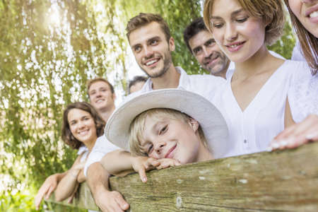 Group of people standing behind fence, portrait