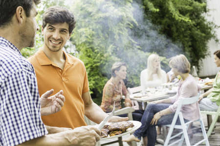 Family enjoying barbecue LANG_EVOIMAGES