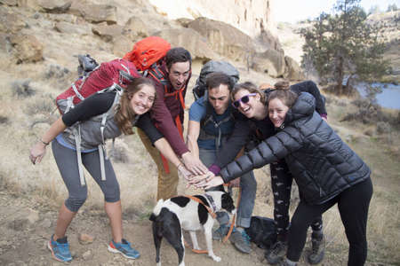 Hikers and dog, Smith Rock State Park, Oregon, US
