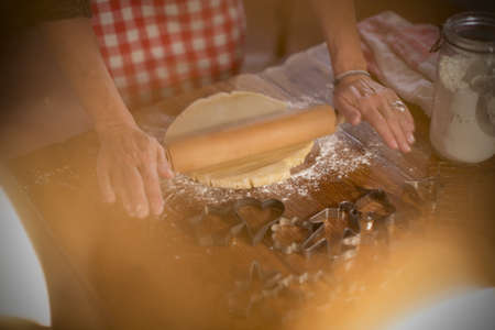 obscuring: Rolling cinnamon and honey dough to make homemade cookies LANG_EVOIMAGES