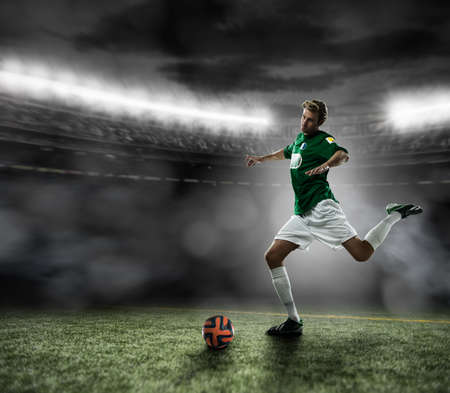 Footballer kicking ball LANG_EVOIMAGES