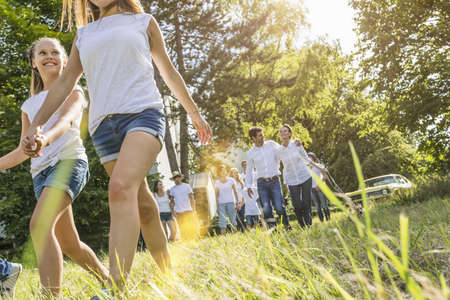 tweens: Group of people walking through forest
