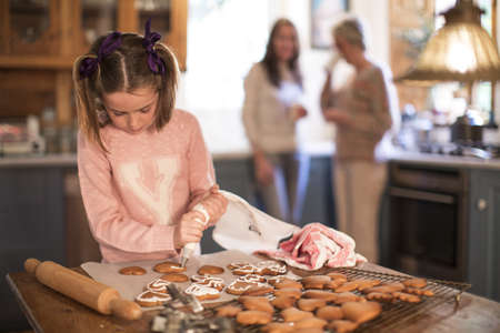 top 7: Girl icing homemade cinnamon and honey cookies