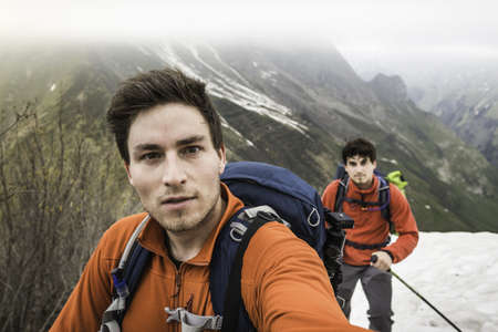 Self portrait of two brothers mountain trekking, Bavarian Alps, Oberstdorf, Bavaria, Germany