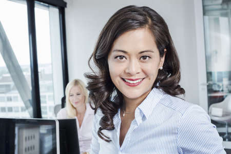 Mature woman in office, portrait LANG_EVOIMAGES