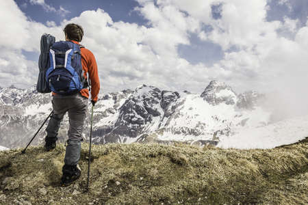 Young man looking at view in Bavarian Alps, Oberstdorf, Bavaria, Germany
