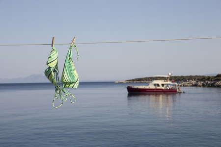 View of bikini hanging on clothes line and  sea, Cappadocia, Anatolia,Turkey LANG_EVOIMAGES