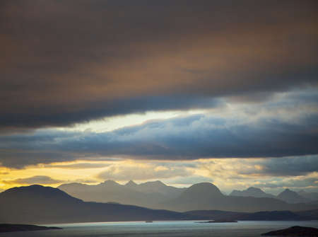 Storm clouds over loch, North West Highlands, Scotland, UK
