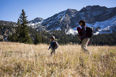 Mother and children hiking, Catherines Pass Trail, Albion Basin, Alta, Utah, USA