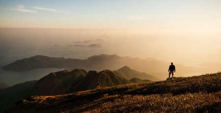 living idyll: Rear view of hiker hiking on Lantau Peak, Lantau Island, Hong Kong, China LANG_EVOIMAGES