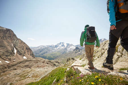 southern european descent: Rear view of young hiking couple at Val Senales Glacier, Val Senales, South Tyrol, Italy