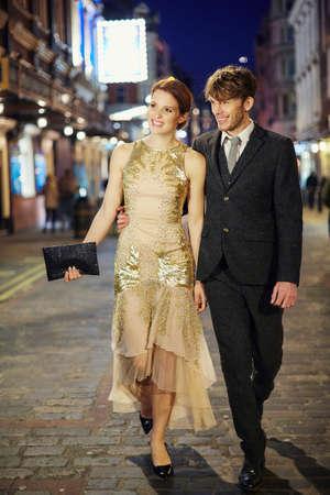 Couple walking on street at night, London, UK LANG_EVOIMAGES